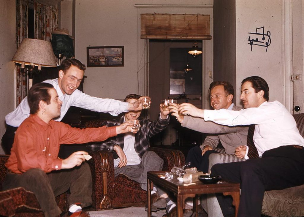 5 men clinking their classes together